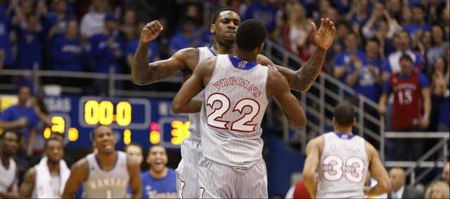 Kansas forward Tarik Black chest bumps teammate Andrew Wiggins after Wiggins finished the first half with a put-back dunk against West Virginia on Saturday, Feb. 8, 2014 at Allen Fieldhouse.