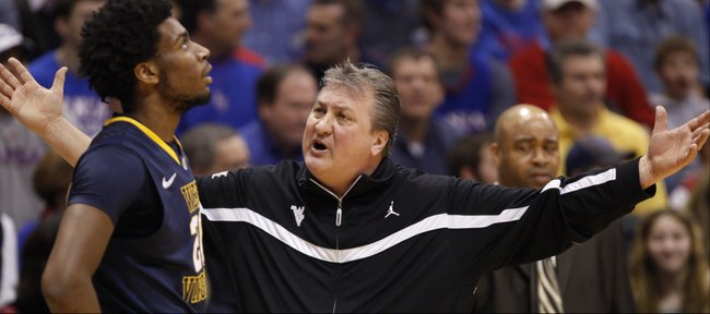 West Virginia head coach Bob Huggins has words for forward Brandon Watkins during the first half on Saturday, Feb. 8, 2014 at Allen Fieldhouse.