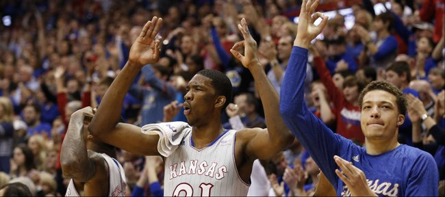 Kansas players Jamari Traylor, left, Joel Embiid, center, and Brannen Greene celebrate a three from teammate Wayne Selden against West Virginia during the second half on Saturday, Feb. 8, 2014 at Allen Fieldhouse.