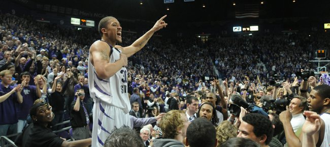 Kansas State forward Michael Beasley pounds his chest as he stands on the scorers table following the Wildcats' 84-75 win over Kansas Wednesday, Jan. 30, 2008 at Bramlage Colliseum.