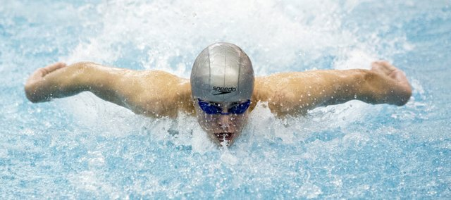 Free State freshman Jordan Portela competes in butterfly portion of the the boys 200 yard medley relay finals at the Sunflower League Championship, Saturday afternoon in Olathe.