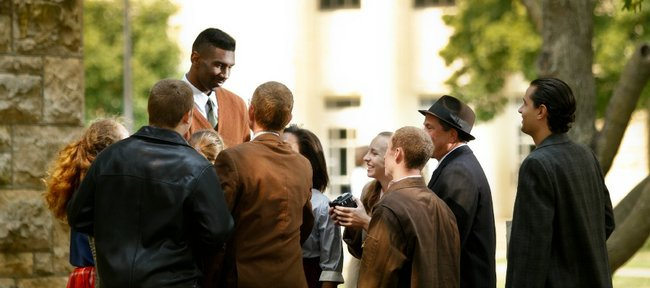 "During a scene from the first day of the filming of ""Jayhawkers,"" outside the School of Architecture, Kansas forward Justin Wesley, playing the part of Wilt Chamberlain, is greeted by various students and faculty upon his arrival at KU. Jayhawkers is a film by Kansas University film professor Kevin Willmott, which focuses on the emergence of Wilt Chamberlain into college basketball."