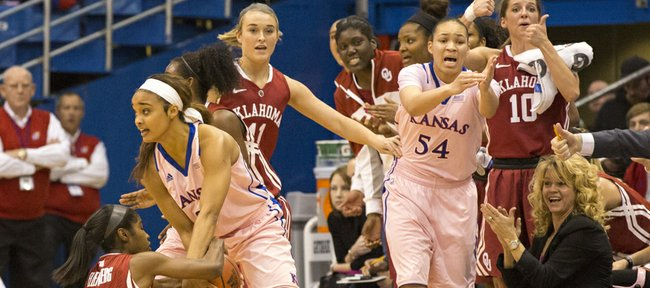 Kansas freshman guard Dakota Gonzalez wrestles for the ball with Oklahoma's Aaryn Ellenberg (3) while Markisha Hawkins (54) signals for a time out during the annual Jayhawks for a Cure game, Sunday at Allen Fieldhouse.