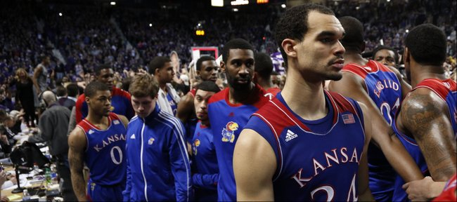 Kansas forward Perry Ellis (34) and his teammates are led off the court as the Kansas State student section celebrates following the Jayhawks' 85-82 overtime loss to Kansas State on Monday, Feb. 10, 2014 at Bramlage Coliseum.