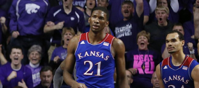 Kansas State forward Thomas Gipson comes down from a dunk before Kansas players Joel Embiid, left, Perry Ellis and Wayne Selden during the second half on Monday, Feb. 10, 2014 at Bramlage Coliseum.