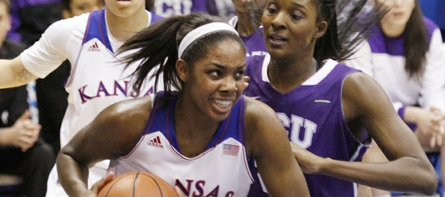 Kansas forward Chelsea Gardner pulls in a rebound beneath the KU basket in the Jayhawks' victory against TCU, Wednesday, Feb. 12, 2014, at Allen Fieldhouse.