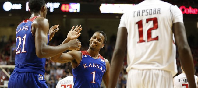 Kansas guard Wayne Selden slaps hands with center Joel Embiid after Embiid drew a Texas Tech foul during the second half on Tuesday, Feb. 18, 2014 at United Spirit Arena in Lubbock, Texas.