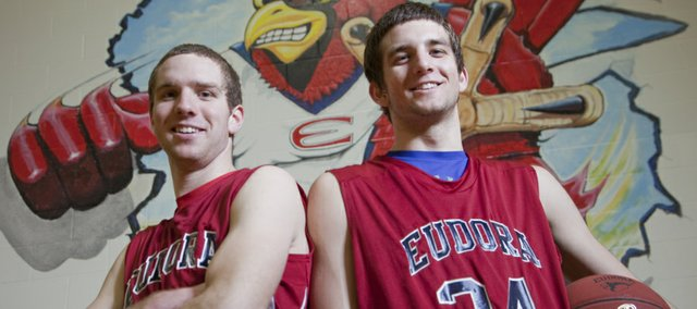 Eudora High senior Andrew Ballock, left, and his brother, freshman Mitchell, play together for the Cardinals' boys basketball team. Mitchell is already drawing attention from Division I basketball programs and attributes his success to the backyard basketball beatdowns he endured at the hands of his older siblings while growing up.