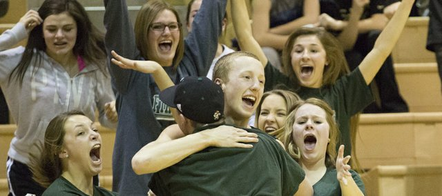 Free State junior Weston Hack, center, is mobbed by Free State students after he hit the game-winning shot with one second left in Free State's game against Olathe East on Friday in Olathe.