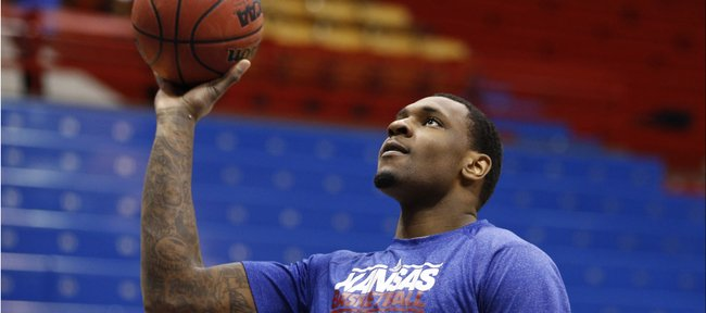 Kansas forward Tarik Black puts up a shot prior to tipoff against Oklahoma on Monday, Feb. 24, 2014 at Allen Fieldhouse.