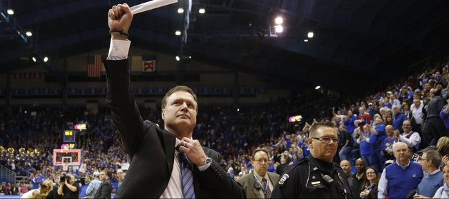 Kansas head coach Bill Self raises a fist to the student section as they salute the the Jayhawks' tenth-straight conference title following their 83-75 win over Oklahoma on Monday, Feb. 24, 2014 at Allen Fieldhouse.