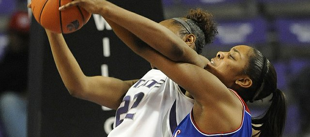 KU's Chelsea Gardner, right, contests a possession by KSU's Breanna Lewis on Saturday, Jan. 25, 2014, in Manhattan.