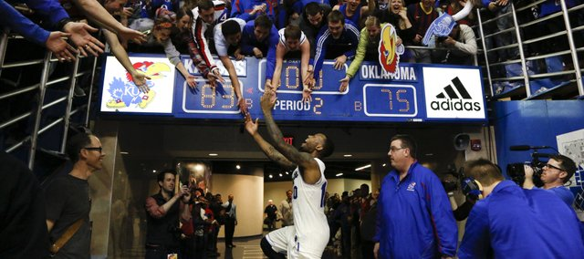 Kansas guard Naadir Tharpe slaps hands with students as he exits the court following the the Jayhawks' 83-75 win over Oklahoma on Monday, Feb. 24, 2014 at Allen Fieldhouse. The win secured a share of a tenth-straight conference title for the Jayhawks.