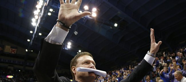 Kansas head coach Bill Self raises up two palms in light of the the Jayhawks' tenth-straight conference title following their 83-75 win over Oklahoma on Monday, Feb. 24, 2014 at Allen Fieldhouse.