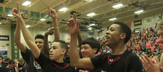 LHS players celebrate their 68-61 victory over Free State on Friday, Feb. 28, 2014, at FSHS.