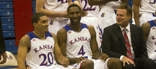 Kansas seniors Niko Roberts (20) and Justin Wesley (4) joke around with coach Bill Self during KU basketball media day on Sept. 25, 2013, at Allen Fieldhouse.