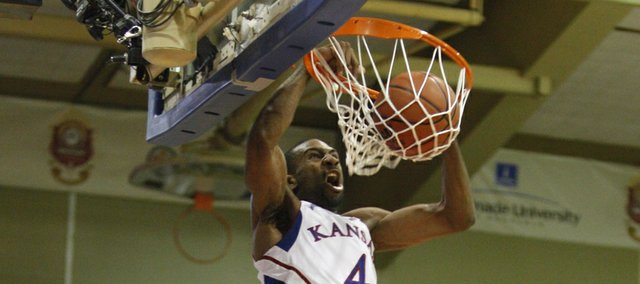 Kansas forward Justin Wesley delivers an alley-oop dunk over Georgetown forward Nate Lubick during the first half on Monday, Nov. 21, 2011 at the Lahaina Civic Center.