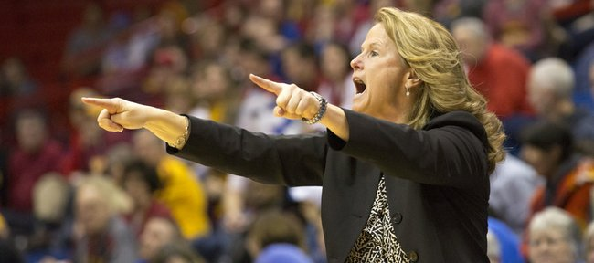 Kansas coach Bonnie Henrickson shouts out instructions during Kansas' game against Iowa State, Saturday evening at Allen Fieldhouse.