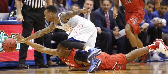 Kansas guard Naadir Tharpe and Texas Tech guard Randy Onwuasor chase a loose ball during the first half on Wednesday, March 5, 2014 at Allen Fieldhouse.