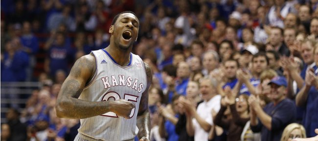 Kansas forward Tarik Black pounds his chest as he checks out of the game for the final time during the second half on Wednesday, March 5, 2014 at Allen Fieldhouse.
