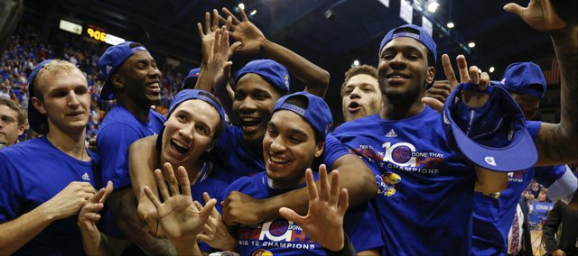 Kansas players huddle together celebrating the programs' tenth-straight conference title following their 82-57 win over Texas Tech on Wednesday, March 5, 2014 at Allen Fieldhouse.