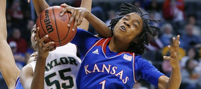 Kansas University's Lamaria Cole (1) and Baylor's Khadijiah Cave (55) fight for a rebound in the second half of an NCAA college basketball game in the quarterfinals of the Big 12 Conference women's college tournament in Oklahoma City, Saturday, March 8, 2014. Baylor won 81-47.