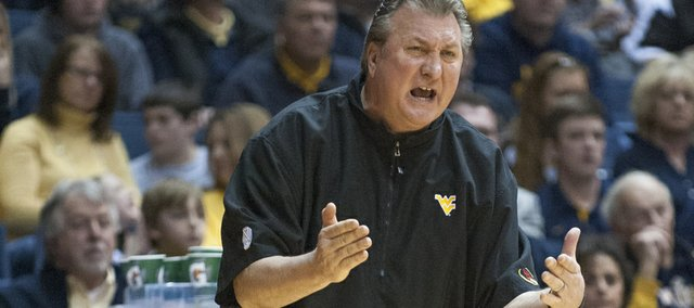 West Virginia's Bob Huggins reacts during the first half of an NCAA college basketball game against TCU, Saturday, March 1, 2014, in Morgantown, W.Va. (AP Photo/Andrew Ferguson)