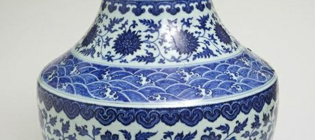"Blue and white porcelain vase with underglazing, from China's Qianlong period (1736-1795). The vase is among artworks in the Spencer Museum of Art's new permanent exhibit, ""Empire of Things."""