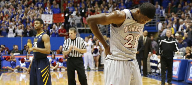 Kansas center Joel Embiid holds his lower back after injuring it during the second half of the Jayhawks' Feb. 8, 2014 game against West Virginia at Allen Fieldhouse.