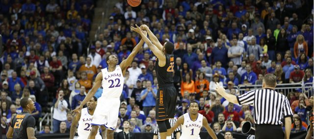 Kansas guard Andrew Wiggins defends against a three from Oklahoma State guard Markel Brown late in the second half on Thursday, March 13, 2014 at Sprint Center in Kansas City, Missouri.