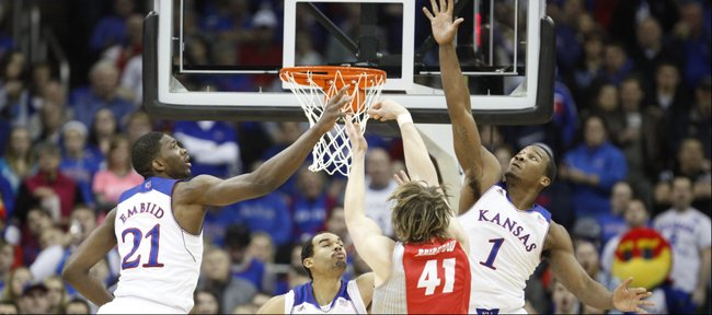 Kansas players Joel Embiid, Perry Ellis and Wayne Selden defend as New Mexico forward Cameron Bairstow puts up a shot during the first half on Saturday, Dec. 14, 2013 at Sprint Center in Kansas City, Mo.