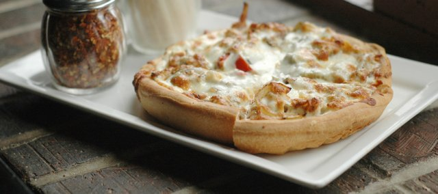 Creamy Chicken Philly Pizza at Henry T's Bar and Grill, 3520 W. Sixth St.