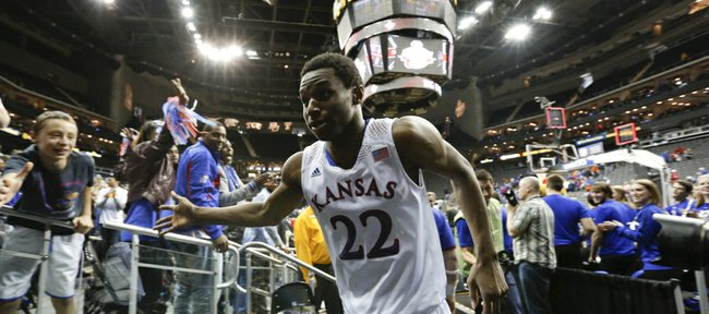Kansas guard Andrew Wiggins slaps hands with Jayhawk fans as the leaves the court following the Jayhawks' 77-70 overtime win against Oklahoma State on Thursday, March 13, 2014 at Sprint Center in Kansas City, Missouri.
