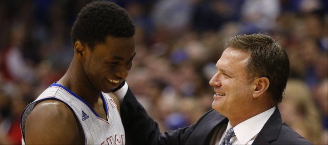Kansas head coach Bill Self smiles and gives a pat to Andrew Wiggins after pulling him from the game late in the second half on Wednesday, March 5, 2014 at Allen Fieldhouse.