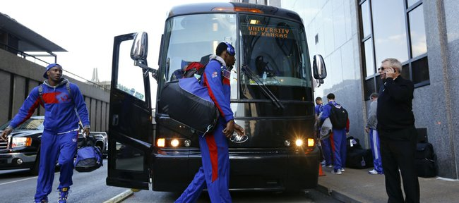 Kansas guard Andrew Wiggins, center, and Jamari Traylor exit the team bus after arriving outside the Hyatt Regency hotel at the Arch, Wednesday, March 19, 2014, in St. Louis. The Jayhawks play their first game of the NCAA Tournament