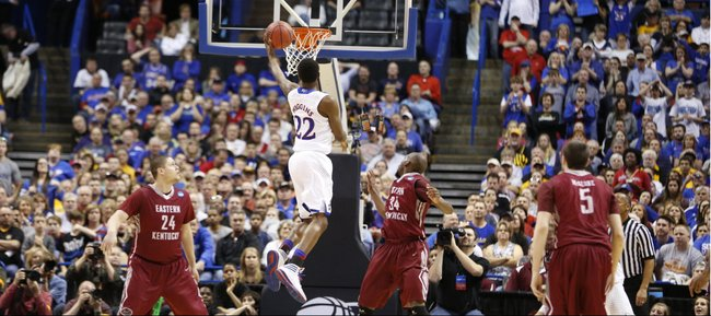 Kansas guard Andrew Wiggins cuts to the bucket for a layup against Eastern Kentucky during the first half on Friday, March 21, 2014 at Scottrade Center in St. Louis.