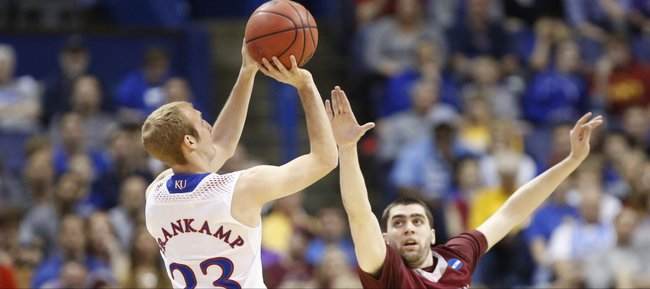 Kansas guard Conner Frankamp pulls up for a shot over Eastern Kentucky guard Isaac McGlone during the first half on Friday, March 21, 2014 at Scottrade Center in St. Louis.