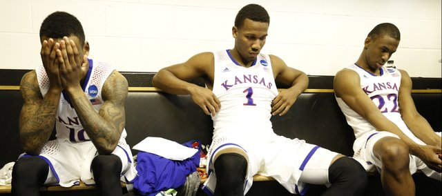 Kansas players Naadir Tharpe, left, Wayne Selden and Andrew Wiggins hang their heads in the locker room following the Jayhawks' 60-57 loss to Stanford on Sunday, March 23, 2014 at Scottrade Center in St. Louis.