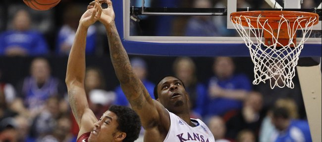 Kansas forward Tarik Black has the ball knocked away by Stanford forward Josh Huestis during the second half on Sunday, March 23, 2014 at Scottrade Center in St. Louis.