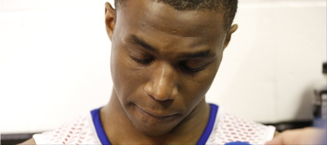 Kansas guard Andrew Wiggins, who is projected to be among the first selected in the 2014 NBA Draft answers questions in the locker room following the Jayhawks' 60-57 loss to Stanford on Sunday, March 23, 2014 at Scottrade Center in St. Louis.