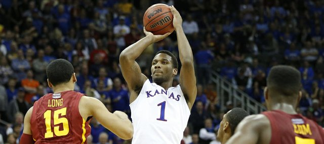 Kansas guard Wayne Selden pulls up for a late three against Iowa State guard Naz Long on Friday, March 14, 2014 at Sprint Center in Kansas City, Missouri.