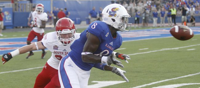 Kansas wide receiver Josh Ford (8) prepares to catch a pass inside the 20-yard line to set up an early 2nd-quarter touchdown for in KU's 31-14 win against South Dakota at Memorial Stadium, Saturday, Sept. 7, 2013.