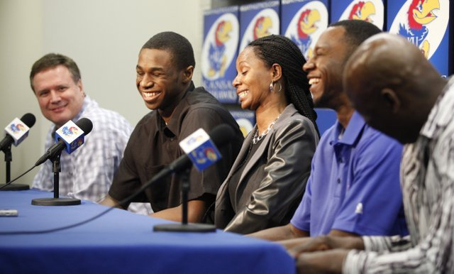 Kansas guard Andrew Wiggins laughs with Jayhawks' head coach Bill Self after Self made a joke about how he could still come back during a news conference in which Wiggins declared his intention to enter the NBA Draft on Monday, March 31, 2014 at Allen Fieldhouse. To his right are his mother Marita Wiggins, brother Mitchell Wiggins Jr. and father Mitchell. Nick Krug/Journal-World Photo