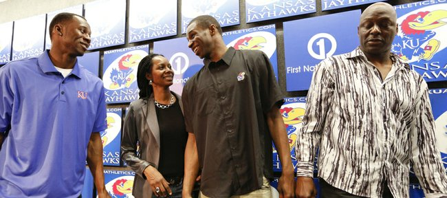 Kansas guard Andrew Wiggins laughs with his brother Mitchell Wiggins Jr., left, mother Marita Wiggins and father Mitchell Wiggins after declaring his intention to enter the NBA Draft during a news conference on Monday, March 31, 2014 at Allen Fieldhouse. Nick Krug/Journal-World Photo