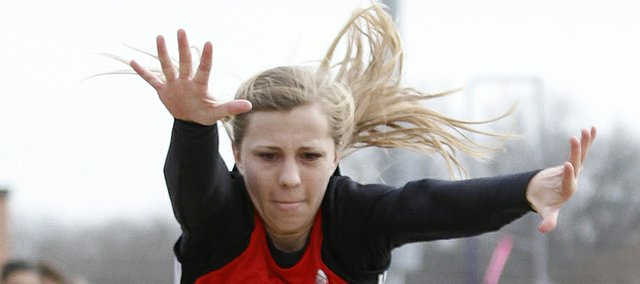 Lawrence High's long jumper Kyleigh Severa stretches out a leap during Tuesday's Lawrence High track meet against Free State at LHS.