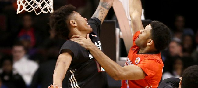 McDonald's West All-American Kelly Oubre, left, blocks the shot of McDonald's East All-American James Blackmon Jr. during the first half of the McDonald's All-American Game on Wednesday in Chicago. Oubre is a Kansas University signee. Blackmon is headed to Indiana.