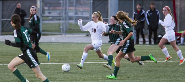 Lawrence High freshman Skylar Drum (18) moves through the Barstow defense during their soccer match Friday at LHS.