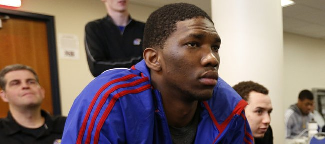Kansas freshman center Joel Embiid listens during teammate Andrew Wiggins' press conference in which Wiggins declared his intention to enter the NBA Draft on Monday, March 31, 2014 at Allen Fieldhouse. Embiid has yet to make a decision about whether he will stay or also enter the draft.