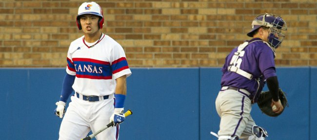 Kansas junior Justin Protacio, left, reacts after striking out while TCU catcher Kyle Bacak heads to the dugout during their game Friday evening at Hoglund Ballpark.