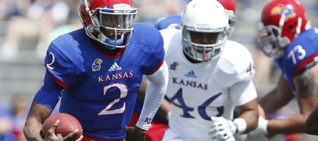 Blue Team quarterback Montell Cozart scrambles in for a touchdown against the White Team during the second half of the Kansas Spring Game on Saturday, April 12, 2014 at Memorial Stadium. Nick Krug/Journal-World Photo
